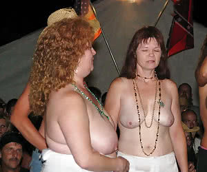 Night party when mature dames acting with naked breasts