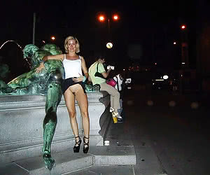 Night public nudity of a young girls on a city streets