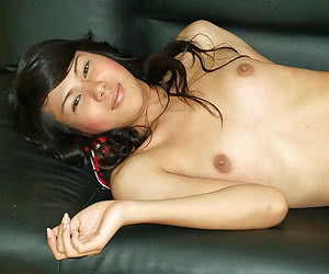 Perfect thai ladyboy stripping and posing on the couch