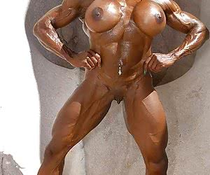Muscle woman naked with dumbells.